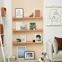 white wall peach bookshelf
