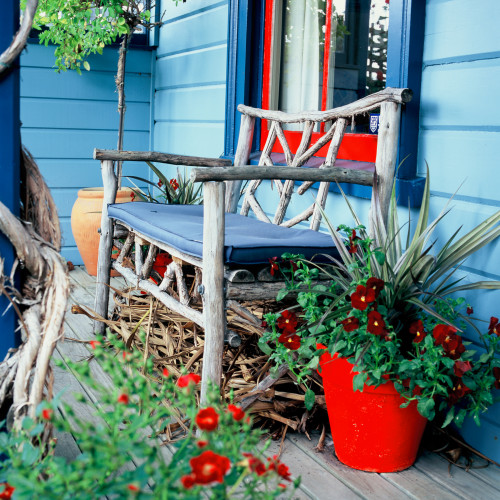 painted exterior, front deck, blue paint, red paint, colourful exterior