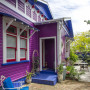 purple house, purple exterior, blue exterior, painted weatherboards, bright house
