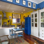 yellow kitchen, blue and yellow paint, blue dining room, blue fridge, bright kitchen