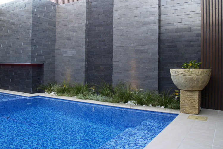 swimming pool, outdoor pool, exterior, water feature, grey wall, grey tiles