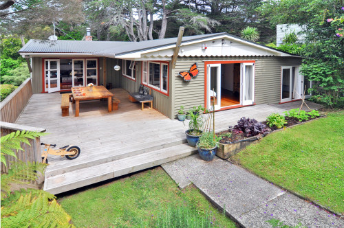 house exterior, painted weatherboards, deck, outdoor living, burnt orange