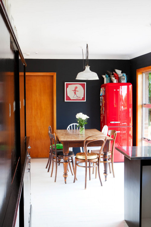 black dining room, open-plan dining, red fridge, black paint