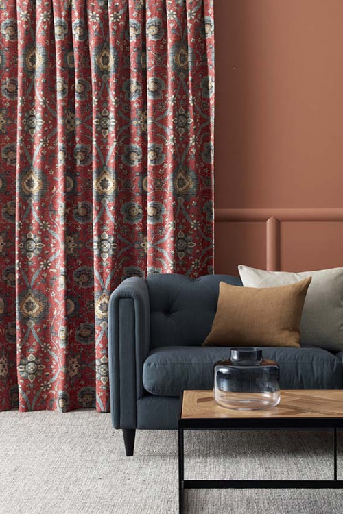 lounge, living room, orange living room, brown lounge, terracotta painted wall, patterned curtains