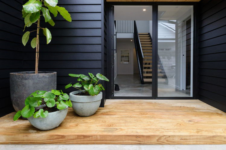 black exterior, resene black, resene alabaster, white walls, scandi design, entrance