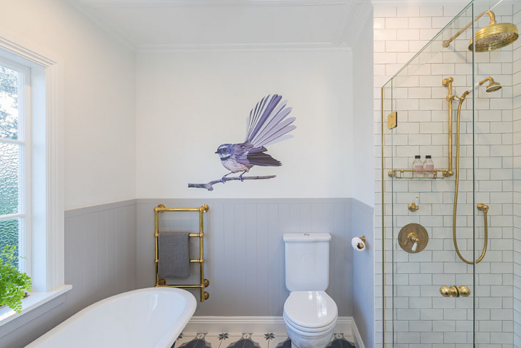 blue bathroom, kids bathroom, tongue and groove, resene, fantail decal, bath tub, brass tapware