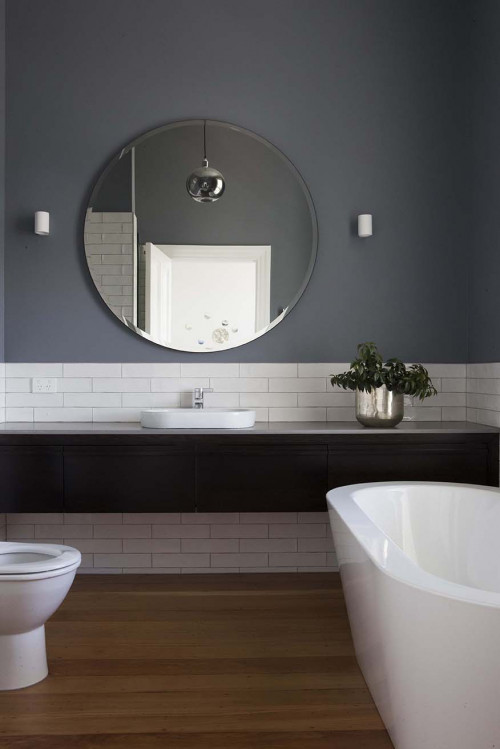 grey bathroom, resene raven, round mirror, white subway tiles, matai, timber floors