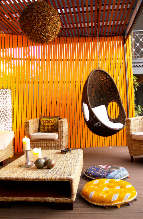 pavilion, orange paint, hanging char, feature wall, timber, contemporary garden, modern exterior