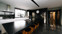 This striking black kitchen is the crown jewel of a contemporary North Otago farmstead photo
