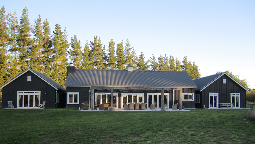 house exterior, barn style house, black house, black exterior, outdoor living area