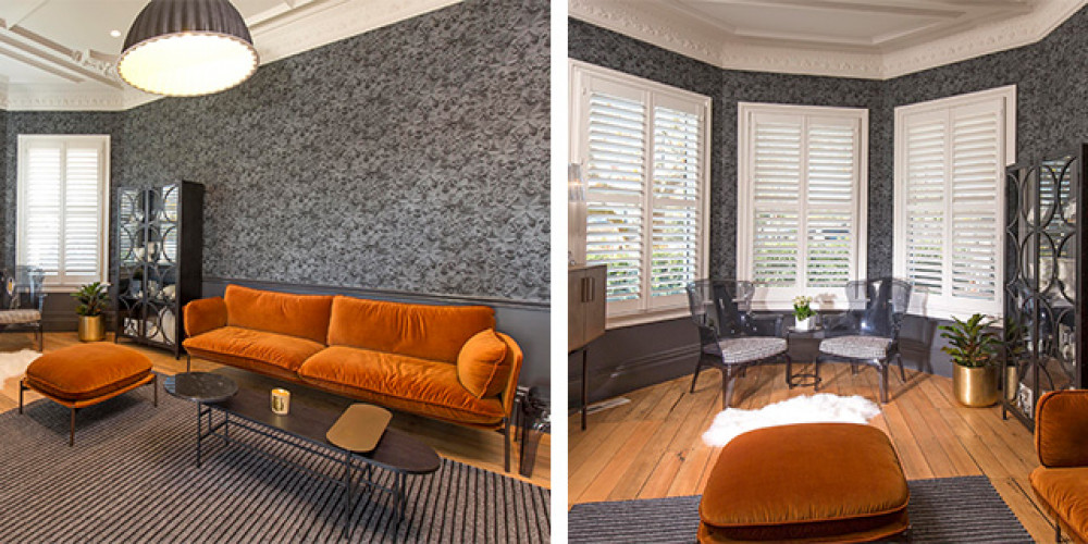 lounge, living room, wallpaper feature wall, grey wallpaper, grey and orange interior, grey lounge