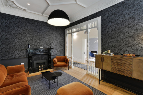 lounge, living room, wallpaper feature wall, grey wallpaper, grey and orange, grey lounge