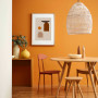 dining room, orange dining room, orange feature wall, 70s inspiration, rattan pendant