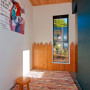 hallway, holiday cabin, dark blue feature wall, timber ceiling, play area
