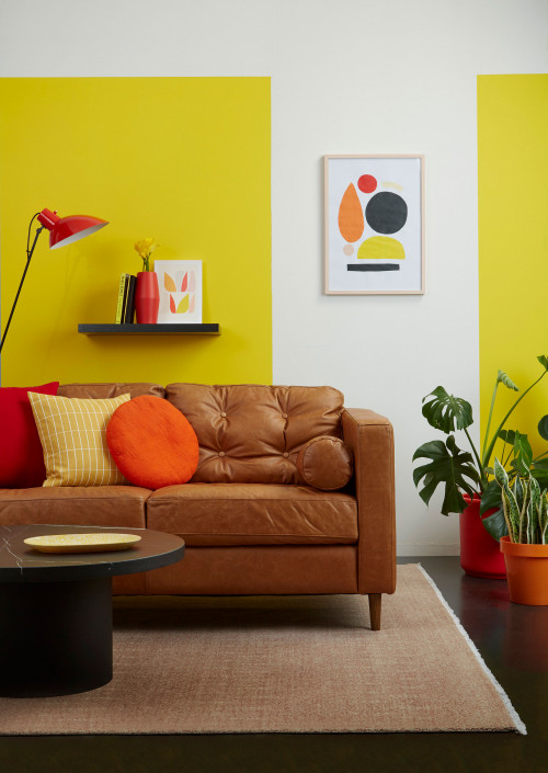 lounge, living room, yellow lounge, yellow living room, leather couch, yellow feature wall