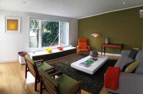 lounge, living room, green feature wall, retro furniture, green lounge, green paint