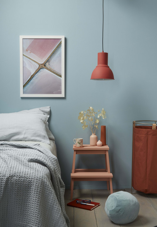 bedroom, blue bedroom, blue and orange, orange accessories, blue feature wall