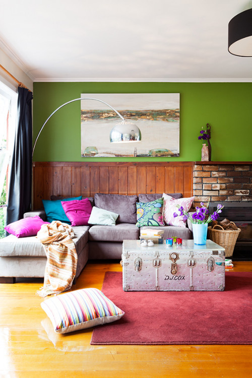 green living room, lounge, interior, home decorating ideas, brick fireplace, painted feature wall