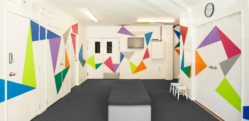 entrance, studio, painted graphic pattern, bright paint, interior design