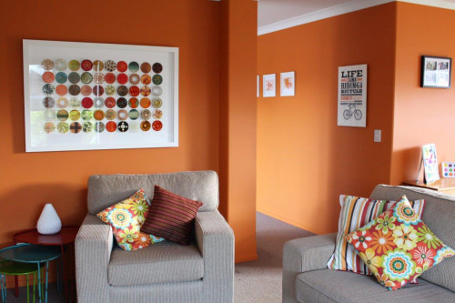 lounge, living room, orange lounge, orange living room, bright living room, orange paint