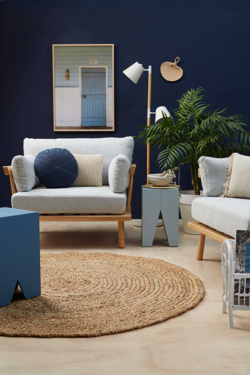 blue living room, blue lounge, resene indian ink, plywood floors, round jute rug, dark feature wall