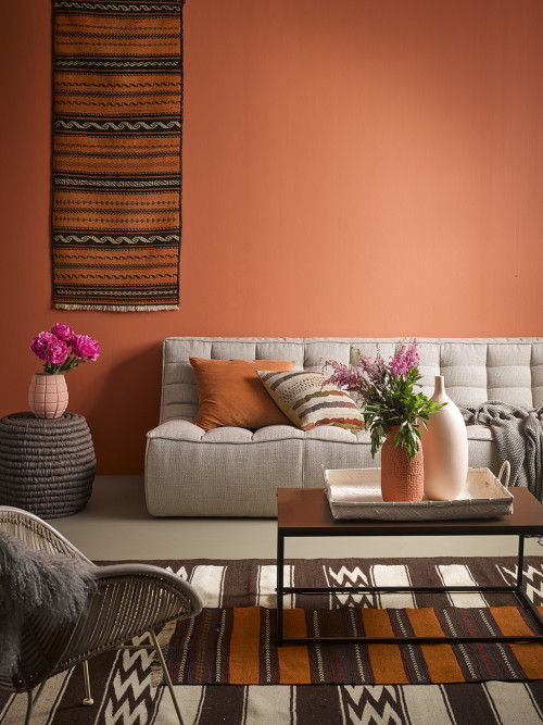 orange lounge, orange living room, hanging rug, brown and orange, resene sunbaked
