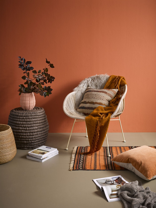 Occasional chair, warm oranges, natural fibres, rug, reading corner, Resene