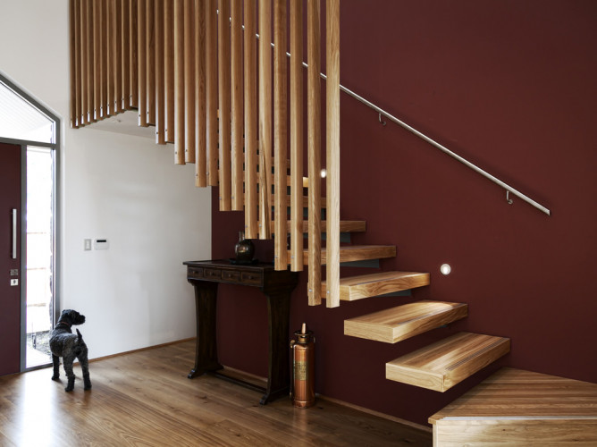 brown entranceway, wooden stairwell, brown painted wall, feature wall, interior