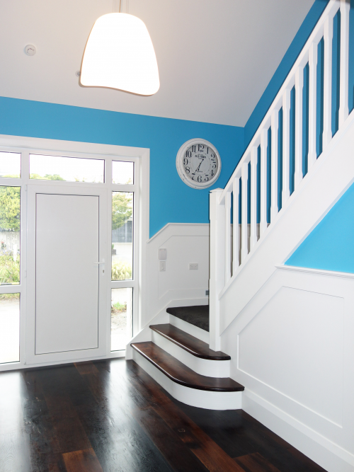 white stairs, white staircase, blue, bright blue, hallway, painted panels, paint ideas, paint trends
