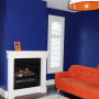 lounge, family room, dark blue, navy blue, orange couch