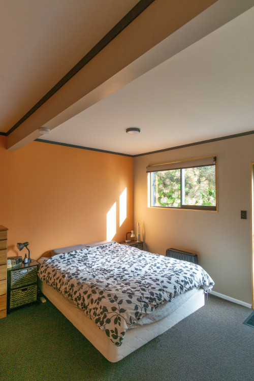 bedroom inspiration, bedroom ideas, peach interior, terracotta interior, orange feature wall, resene