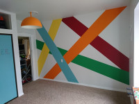 Aron Taaffe creates colourful mural in son's bedroom